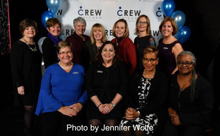 CREW Chicago past presidents gathered for a photo during the celebration, with current president Mary Fuller and CREW Network CEO Wendy Mann, CAE