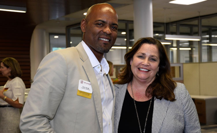 CREW Jacksonville member Tony Terrell with CREW Network CEO Wendy Mann