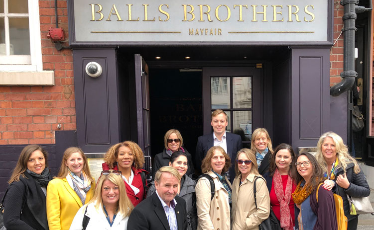 CREW Network Global Study Mission group poses in front of Balls Brothers in Mayfair
