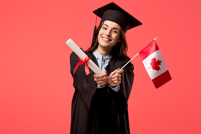 Female student with a diploma and a Canadian flag
